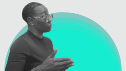 Nina Turner against a green and white background