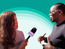 Nina Turner speaks with PH interviewer against a white and green background
