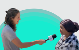 PH team member interviews a local voter against white and green background