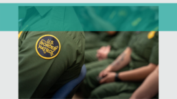 Border patrol agents are shown sitting from the neck down