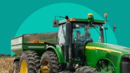John Deere tractor in a field on progressive hub green background